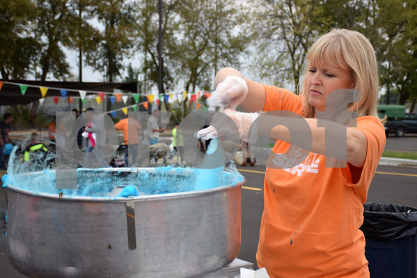 Lori Grubbs of Sycamore makes cotton candy during Christ Community Church's Harvest Fest and Open House on Friday at the church's new location, 2350 Pride Ave. in DeKalb. The event continues Saturday from 11 a.m. to 4 p.m. and concludes with a church service at 5:10 p.m.