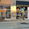 Eric R. Olson –eolson@shawmedia.com<br /> Police, firefighters and a tow truck driver at the scene where a vehicle crashed through the front of the DeKalb Buffalo Wild Wings restaurant on Tuesday. Police said the driver was distracted and hit the gas pedal by mistake.