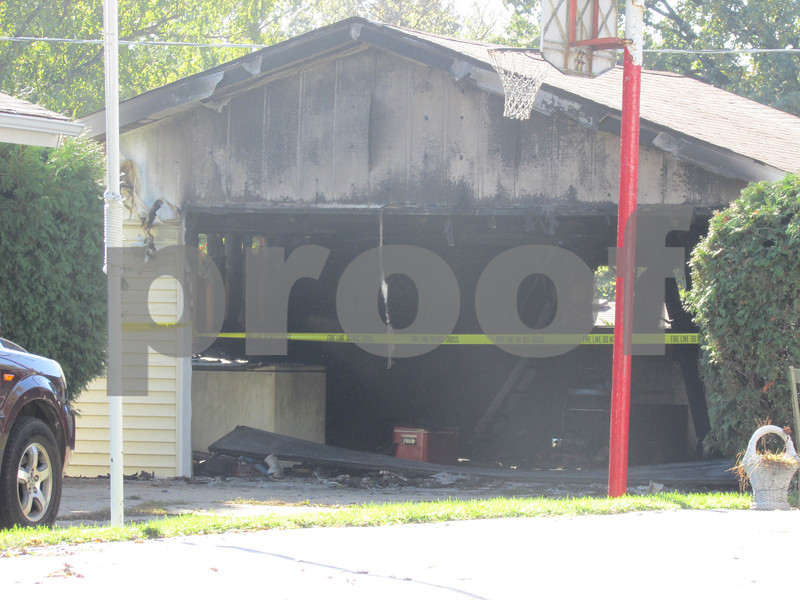 A garage on 212 River St. in DeKalb experienced heavy damage after a fire Sunday evening.