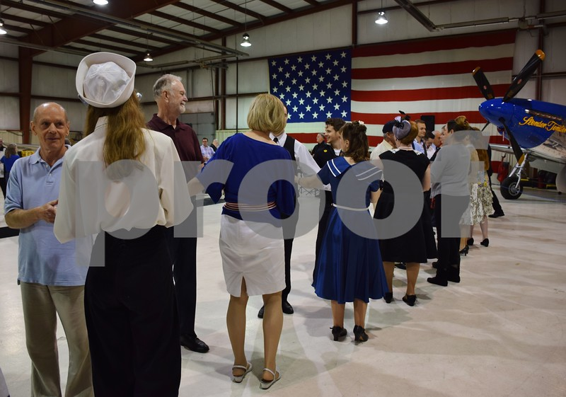 More than 180 people attended the third annual USO Fundraiser Hangar Swing Dance event Saturday at DeKalb Taylor Municipal Airport. At the beginning of the event, couples lined in pairs for dance lessons by Carl Linder and Karrie Willis.