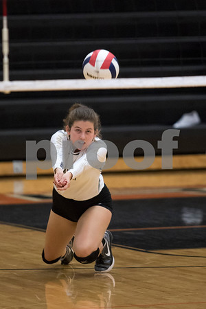 Sam Buckner for Shaw Media.<br /> Grace Knapp bumbs the ball on Tuesday October 17, 2017 at Dekalb High School.