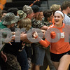 Sam Buckner for Shaw Media.<br /> Lydia Sabanish high fives the student section after winning the second game against Sycamore on Tuesday October 17, 2017.