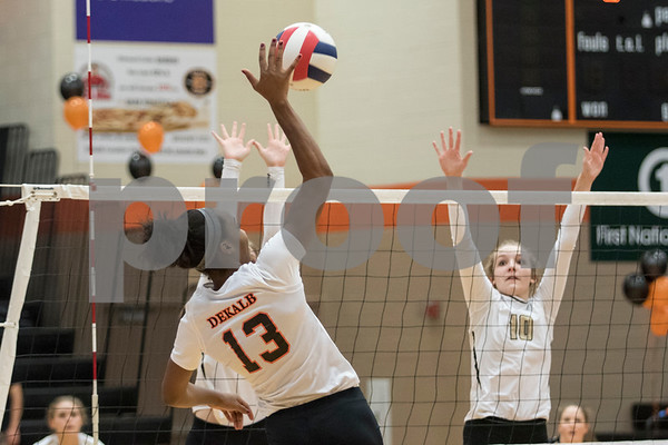 Sam Buckner for Shaw Media.<br /> Jasmine Kemp spikes the ball on Tuesday October 17, 2017.
