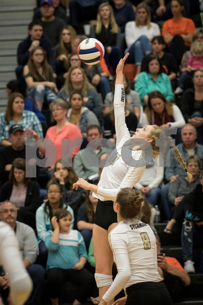 Sam Buckner for Shaw Media.<br /> Kylie Feuerbach hits the ball on Tuesday October 17, 2017 at Dekalb High School.