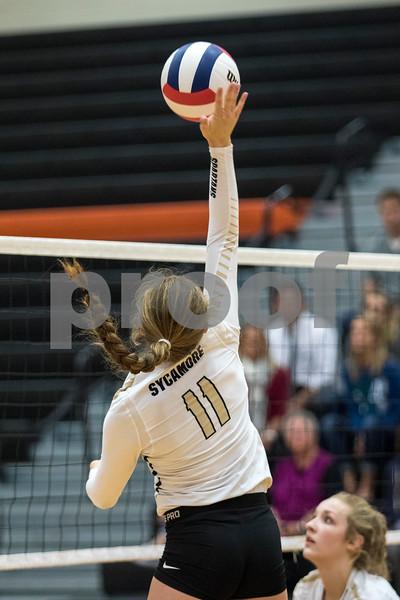 Sam Buckner for Shaw Media.<br /> Faith Reynolds spikes the ball on Tuesday October 17, 2017 at Dekalb High School.