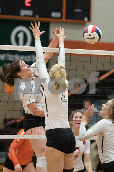 Sam Buckner for Shaw Media.<br /> Emma Fellabaum spikes the ball on Tuesday October 17, 2017 against Sycamore.