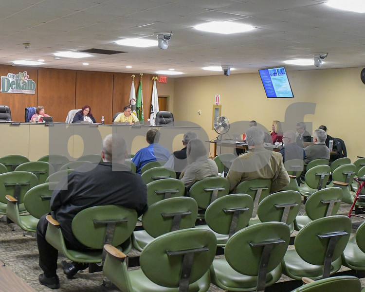 Community Development Director Jo Ellen Charlton talks and shows slides of the Annie Glidden North Revitalization Plan on October 17th during the Planning and Zoning meeting. While providing slides as she speaks about the plan.