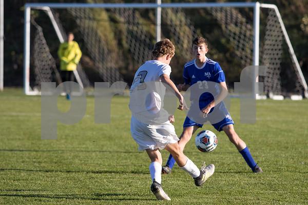 Sam Buckner for Shaw Media.<br /> Connor Bottorff kicks the ball towards Marmions goal on Wednesday October 18, 2017.