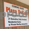 A sign promoting the upcoming Plaza DeKalb apartment project sits on a wall at the developments'  site at the corner of Second Street and Lincoln Highway in DeKalb.