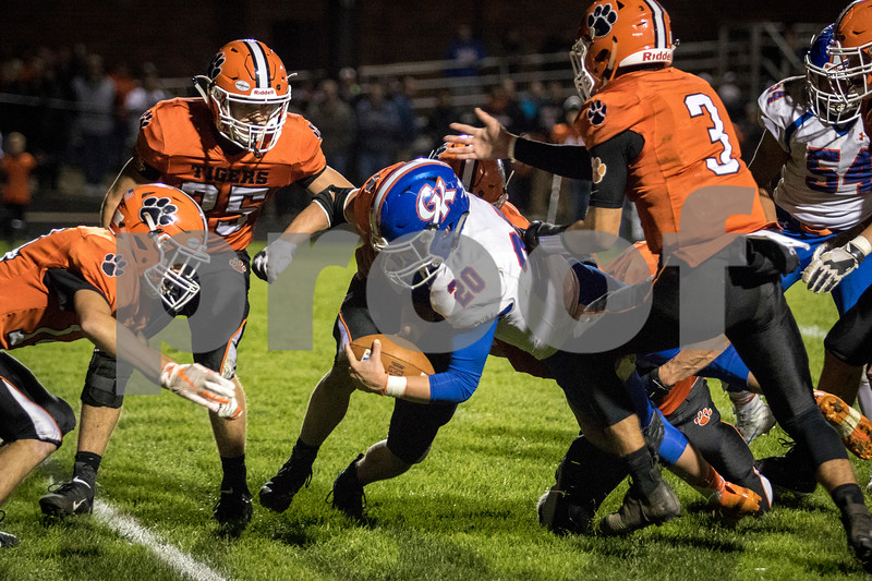 Sam Buckner for Shaw Media.<br /> Justin Peters lunges himself into a group of Byron defenders on Friday October 18, 2019 in Byron.