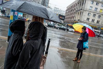 Pedestrians and sidewalk, in the rain, Warsaw, Poland