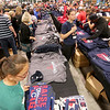 Jonathan Tressler - The News-Herald<br /> Employees at Dick's Sporting Goods in the Great Lakes Mall in Mentor work to keep ahead of the shopping frenzy that ensued following the Indians 3-0 victory over the Toronto Blue Jays in game 5 of the ALCS Oct. 19.