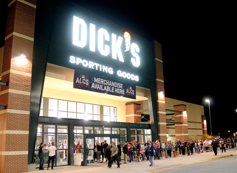 Jonathan Tressler - The News-Herald<br /> The line outside the east entrance of Dick's Sporting Goods at the Great Lakes Mall in Mentor literally wrapped around the building Oct. 19 following the Cleveland Indians 3-0 win against the Toronto Blue Jays in the ALCS game 5.