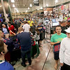 Jonathan Tressler - The News-Herald<br /> Cleveland Indians fans line up inside Dick's Sporting Goods at the Great Lakes Mall in Mentor Oct. 19 following the Tribe's 3-0 win against the Toronto Blue Jays in game 5 of the ALCS.