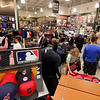 Jonathan Tressler - The News-Herald<br /> A flurry of sports fans converges on Cleveland Indians apparel and accessories Oct. 19 inside Dick's Sporting Goods at Great Lakes Mall in Mentor folllowing the Tribe's 3-0 win over Toronto in game 5 of the ALCS.