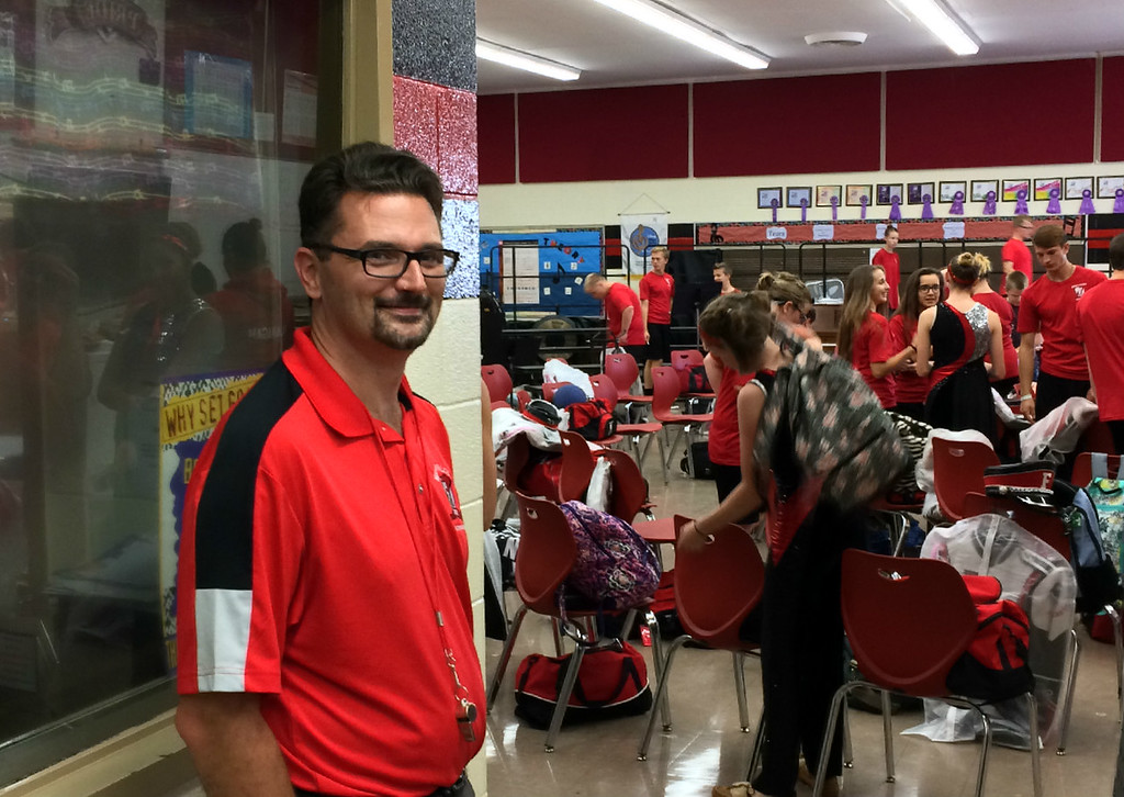 . Carol Harper � The Morning Journal <br> Firelands Band Director Dustin Wiley says frenetic activity of volunteer parents and students before boarding a bus Oct. 13, 2017, for a weekend of two performances is like a well oiled machine at Firelands High School, 10643 Vermilion Road near Oberlin.