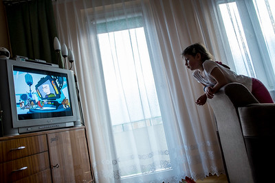 Gir age 5,6,7 at home watching TV, Starachowice, Poland