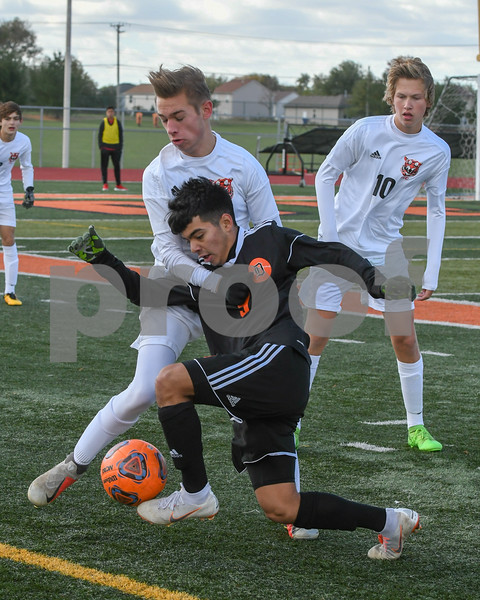 Dekalb Gonzalo Hernandez (9) tries to get around Crystal Lake Central Kacper Pruszynski (19) in the first half of October 20th regional title game.