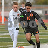 Crystal Lake Central Kacper Pruszynski (19) and Dekalb Andrew J. Leon (10) battle for the ball in the first half of the regional title game on October 20th.