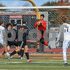 Dekalb's goal keeper Victor Guerrero saves a goal in the first half of the regional title game on October 20th agents Crystal Lake Central.