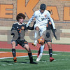 Crystal Lake Central Jairo Aguilar (16) controls the ball and kicks the ball away from Dekalb defenders Dekalb Emrys Draper (22) and Dekalb Isaak Cordova (5) in the first half of the regional title game held on October20th.