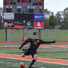 Dekalb Emrys Draper (22) kicks the ball up field during the second half of the regional title game October 20th agents Crystal Lake Central.