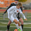 Crystal Lake Central Jake Nelson (10) plays keep away from Dekalb Andrew J. Leon (10) in the first half of October 20th regional title game.