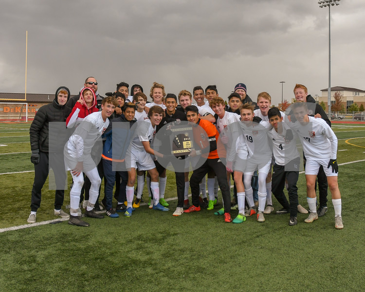 Crystal Lake Central boys soccer team pose for a photo after receiving the regional title plaque October 20th beating out higher seed Dekalb 1-0.