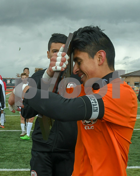 Crystal Lake Central Joseph Perez Tellez (1) hugs the regional title plaque after receiving it from the Dekalb Athletic Director on October 20th beating out Dekalb in a 1-0 game in the regional title game.