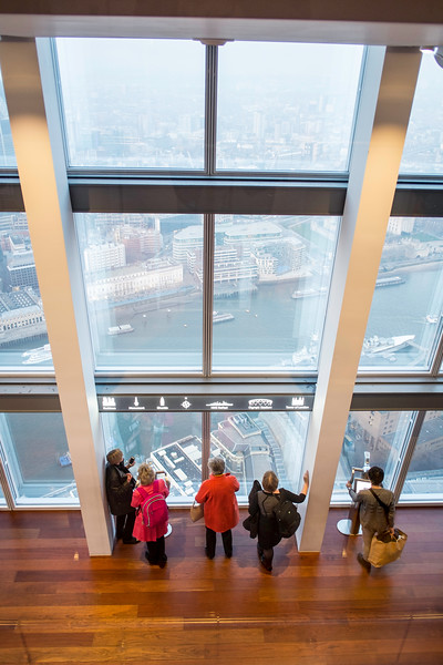Visitors admiring panorama of London from The Shard, London Bridge, London, United Kingdom