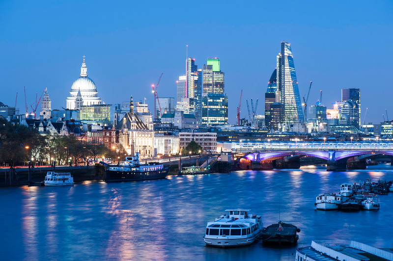 Night view of Thames River and the City of London, London, United Kingdom