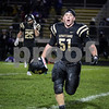 Sam Buckner for Shaw Media.<br /> Brett Swartzendruber yells in celebration as he runs to the Sycamore student section after defeating Rochelle on Friday October 21, 2016.