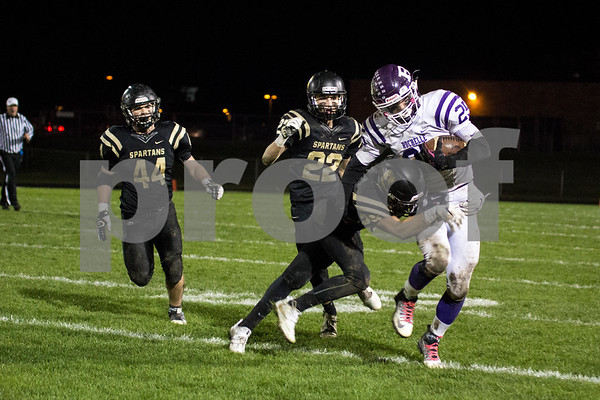 Sam Buckner for Shaw Media.<br /> Abraham Lesniewski takels a Rochelle running back on Friday October 21, 2016.