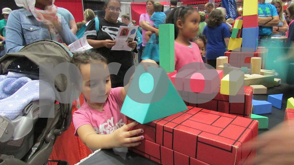 Kaileigh Thompson, 4, builds at Blockfest, one of the many hands-on stations at STEMfest on Saturday at Northern Illinois University.