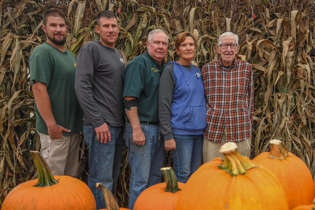 . The Fitch family celebrates six generations of family farming since it began in 1855. Pictured from right to left are: Grandfather Robert Fitch; daughter-in-law Rita Fitch (nee Zilka); father Richard Fitch and grandsons Adam and Dan Fitch. (Eric Bonzar�The Morning Journal)
