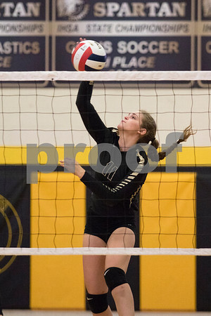 Sam Buckner for Shaw Media.<br /> Faith Reynolds spikes the ball on Monday October 23, 2017.