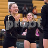 Sam Buckner for Shaw Media.<br /> Ella Carpenter and Faith Reynolds celebrate a point against North Chicago on Monday October 23, 2017.