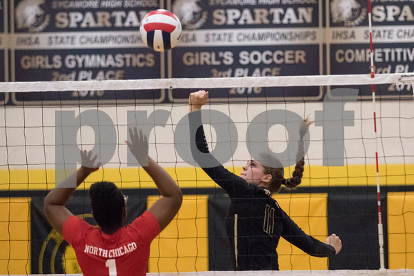 Sam Buckner for Shaw Media.<br /> Faith Reynolds hits the ball over the net on Monday October 23, 2017 against West Chicago.