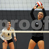 Kaneland player Grace Franz sets the ball as teammate Julianna Vassallo looks on in the Burlington Central Regional tournament on Tuesday night.  Steve Bittinger - For Shaw Media