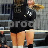 Shelby Hannula (15) of Kaneland spikes the ball as Kylie Feuerbach of Sycamore blocks in the Burlington Central Regional tournament on Tuesday night.  Steve Bittinger - For Shaw Media