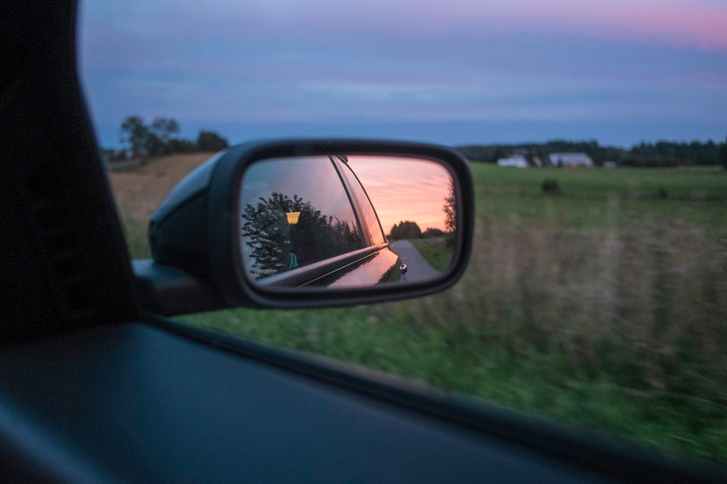 Travelling by car, view in side view mirror, Poland