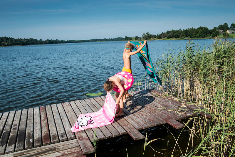 Family enjoying summer by the lake, Giby, Poland