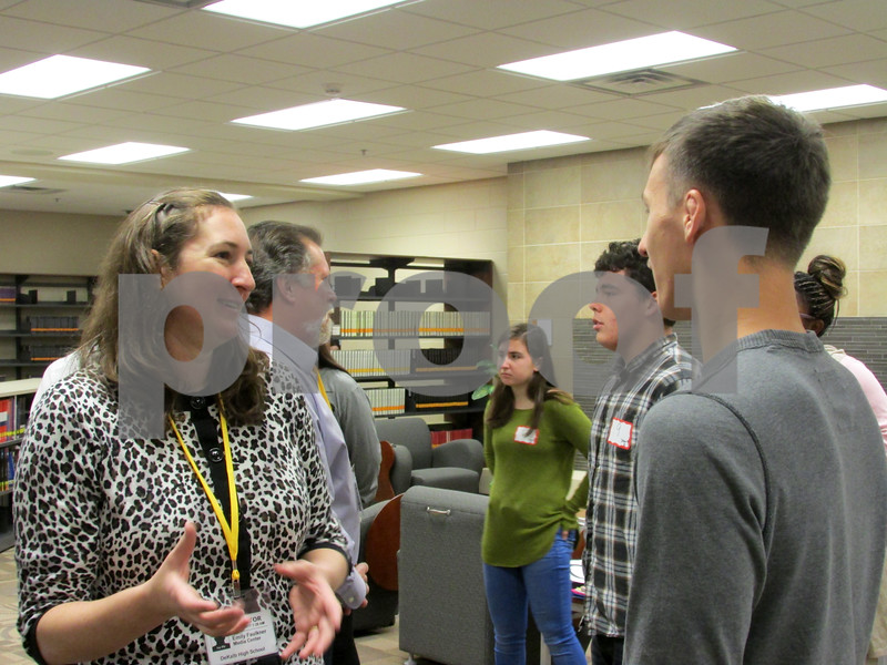 Emily Faulkner (left), director of the DeKalb Public Library, speaks with DeKalb High School student Austin Monk to evaluate his communication skills during a special workshop designed to assess the soft skills of junior and senior students Tuesday at DeKalb High School.