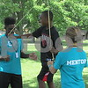 Drew Zimmerman – dzimmerman@shawmedia.com<br /> Bryson Butler (left) and Kristen Dawidiuk (right) help kids cross a slack line obstacle, one of many activities at the annual Camp Power summer program for children who live at the mostly low-income University Village Apartments.