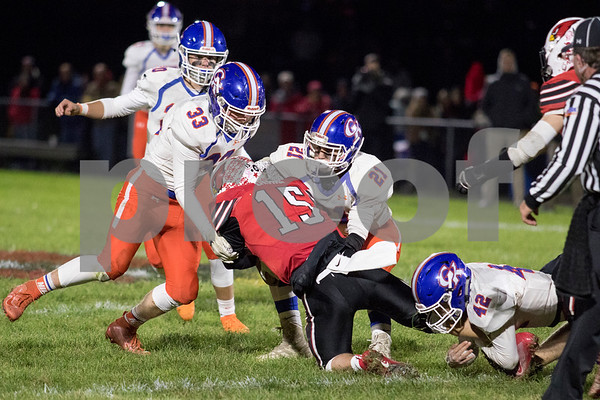 Sam Buckner for Shaw Media.<br /> A group of Cogs make a tackle on Friday October 25, 2019 at Stillman Valley.