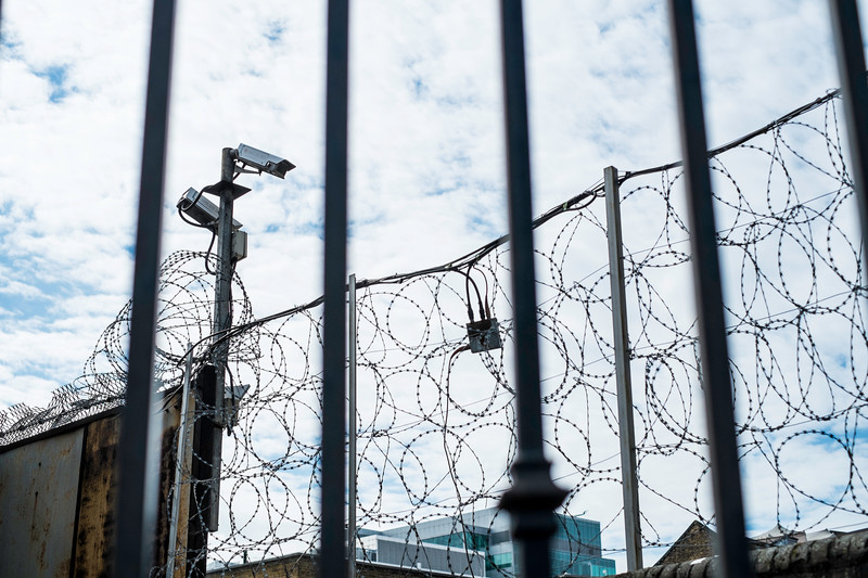 CCTV and barbed wire, London, United Kingdom