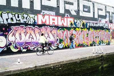 Graffiti on the wall by the canal, Hackney Wick, London, United Kingdom