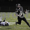 Sycamore quarterback Grant McConkey gains some yards in first half action against Rochelle Friday night.  Steve Bittinger - For Shaw Media