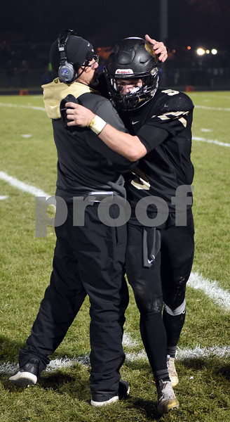 Spartan Head Coach Joe Ryan gives quarterback Grant McConkey a pat on the helmet in the final minute of a victory over Rochelle on Friday in Sycamore.  Steve Bittinger - For Shaw Media