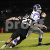 Griffin Nelson of Sycamore chases down Rochelle quarterback Andrew Johnson Friday night.<br /> Steve Bittinger - For Shaw Media